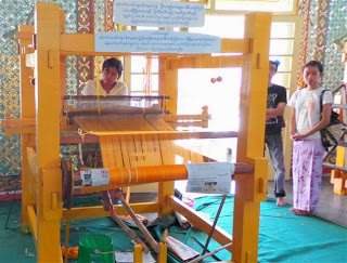 Weaving saffron coloured fabric for monks robes