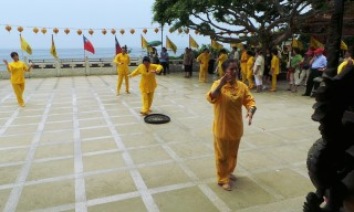 Yellow suited temple dancers