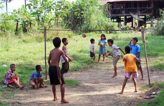 Children playing foot volleyball