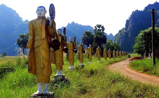 Statues along the track to the cave