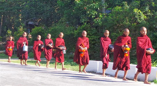 Monks setting off to beg for food
