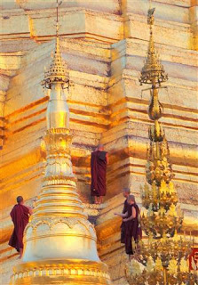 Monks Applying Gold Leaf to the Stupa