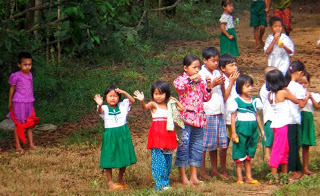Schoolchildren waving