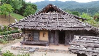 Bark Roofed Mountain  Houses